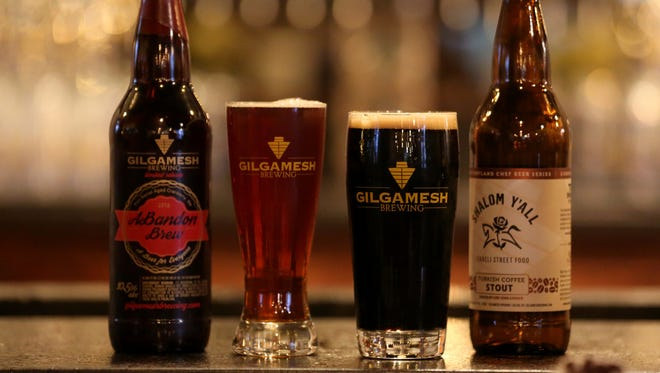 The ABandon Brew, left, a port barrel aged cranberry ale with the cranberries coming from Bandon, Ore., and the Shalom Y'all, a Turkish coffee stout, part of the chef series inspire by Israeli street food, are both part of the winter brew selection at Gilgamesh Brewing in Salem on Thursday, Dec. 8, 2016.