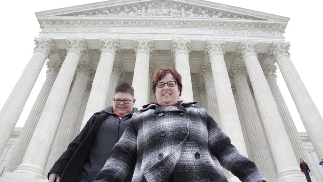 Jayne Rowse, 50, left, and April DeBoer, 44, walk down the steps of the U.S. Supreme Court in Washington D.C. Saturday Apr. 25, 2015.