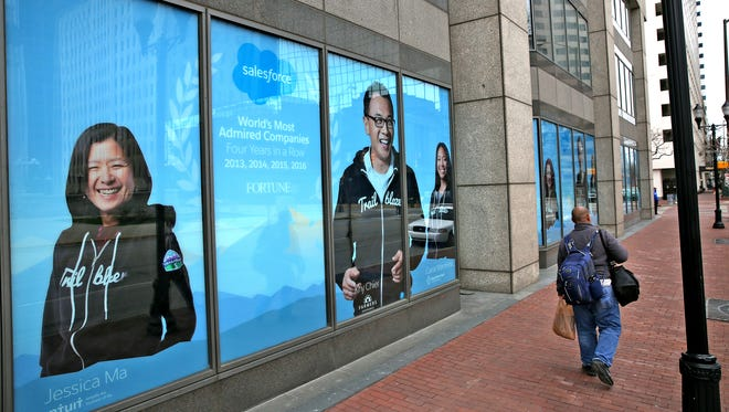 Signs promote Salesforce at the Downtown building.