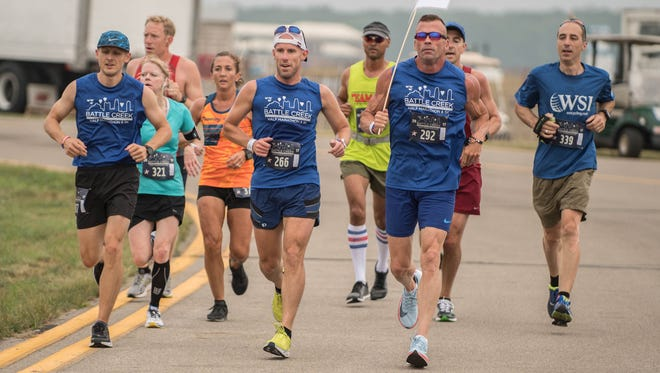 Brad Polnasek (far left) will be one of the pacers for the Battle Creek Half Marathon on Saturday at the W.K. Kellogg Airport.