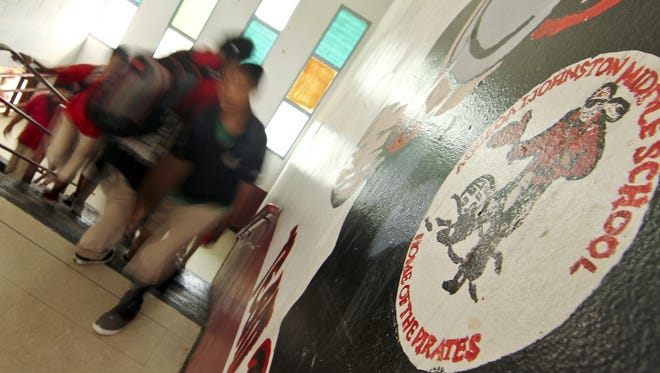 In this February 2013 file photo, Agueda Johnston Middle School students take the stairs as they proceed to their homerooms.