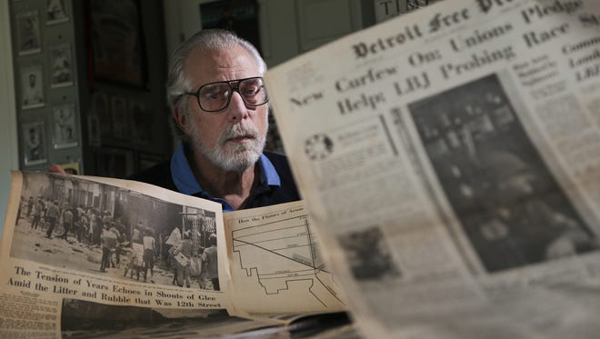 Alan Feldman, 69, of Pontiac is seen with newspaper editions of the Detroit Free Press from the time of the 1967 Detroit Riot at his home on Friday July 21, 2017. Feldman, who was 19 and a MSU student, worked at Uncle Harry's  Name Brand Cancellation Shoes store at 12th and Clairmount that was the second store to burn down during the riot.