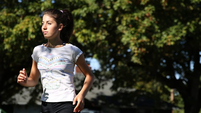 Laura Oppedisano, a senior foreign exchange student from Italy, competes in cross country for Dallas High School. Photographed in Dallas, Ore., on Wednesday, Sept. 13, 2017.