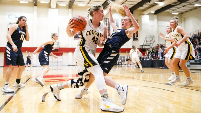 Cascade's Halle Wright (42) grabs a rebound and knocks over Stayton's KJ Nyquist (4) in a quarterfinal game on Thursday, March 8, 2018, at Pacific University in Forest Grove.