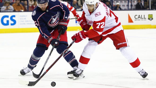 Columbus Blue Jackets left wing Thomas Vanek (26) plays the puck against Detroit Red Wings left wing Andreas Athanasiou (72) in the third period at Nationwide Arena on Friday, March 9, 2018.