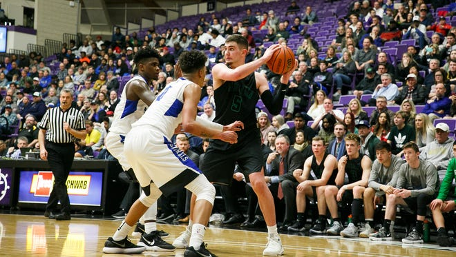 West Salem's Kyle Greeley (5) looks for an open teammate in a quarterfinal game against Grant on Thursday, March 8, 2018, at University of Portland. West Salem lost to Grant 72-57.