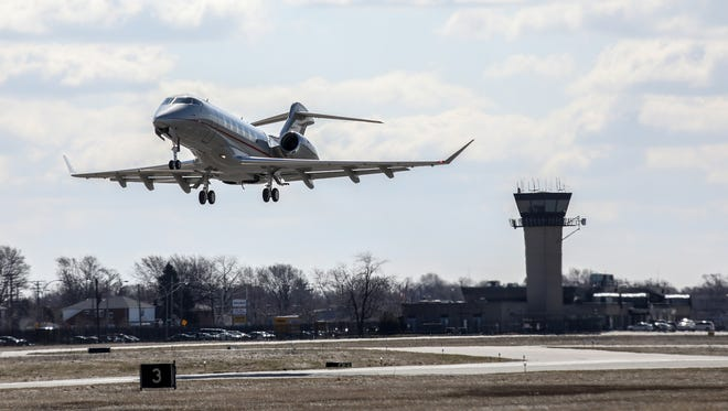 A private jet takes off from Coleman A. Young International Airport in Detroit on Thursday, April 5, 2018. The Traffic Control tower is in the background.