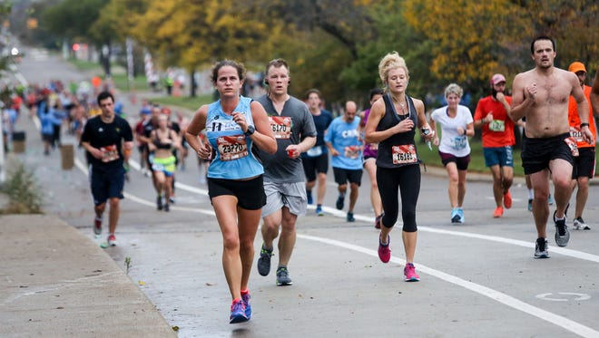 Runners make their way down Rosa Parks Blvd, during the 40th Annual Detroit Free Press/Chemical Bank Marathon in Detroit on Sunday, Oct. 15, 2017.
