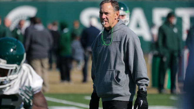 Michigan State University football head coach Mark Dantonio watches players during the team's first spring practice in March.