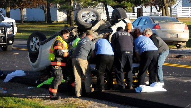 Members of the Grinnell Fire Department and Midwest Ambulance work to prepare Kitty Sue Wagner, Ladora, for transport to Grinnell Regional Medical Center after a two-vehicle accident on eastbound Highway 6 on Thursday, Nov. 11.