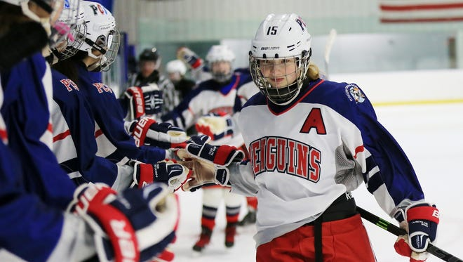Celebrating with teammates after scoring a goal recently is PCS Penguins senior forward Cathryn VandenBosch. pa;pc