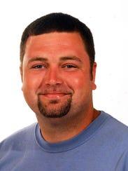 Dustin Stillinger, an International Society of Arboriculture-certified