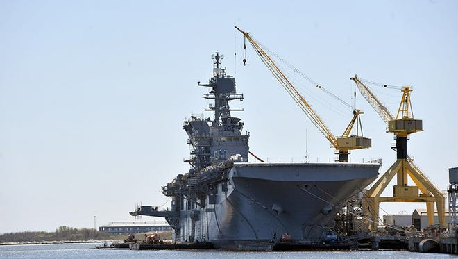The America (LHA-6), an America class amphibious assault ship, sits at the end of the yard at Ingalls Shipbuilding in Pascagoula as it undergoes final fittings for delivery in 2013.