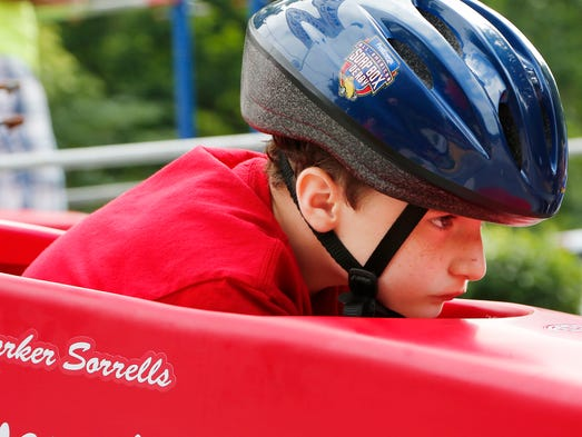 Parker Sorrells, 8, focuses on the course in front of him before the start of a heat during the running of the 2014 Greater Lafayette Soap Box Derby Saturday, June 21, 2014, on Grant Street in front of West Lafayette High School.