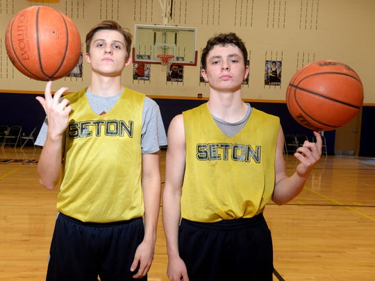 Seton Catholic High School basketball players Sam Brenneke, left, and Trent Reichley at practice Tuesday, March 8, 2016 in Richmond.