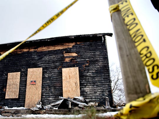 The charred remains of a home on Cottage Street is