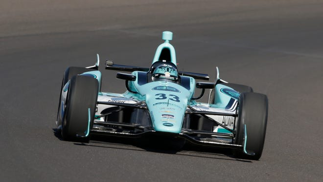 James Davison, of Australia, drives through the first turn on the first day of qualifications for Indianapolis 500 IndyCar auto race at the Indianapolis Motor Speedway in Indianapolis, Saturday, May 17, 2014.
