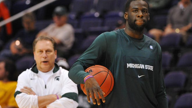 Michigan State Spartans forward Draymond Green (right) and head coach Tom Izzo (left) watch during practice the day before the semifinals of the west region of the 2012 NCAA men's basketball tournament at US Airways Center.