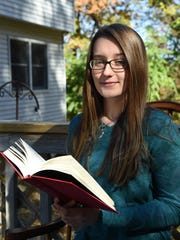 "Scary Stories winner for 9-12th grade, Felicity Schaffer at her home in Staatsburgh on Tuesday. Schaffer is a tenth grader who is home schooled, and authored the story, ""Hide and Seek""."