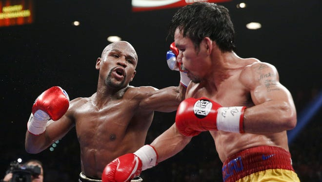 Floyd Mayweather Jr. fights Manny Pacquiao during their welterweight unification championship boxing fight on May 2.