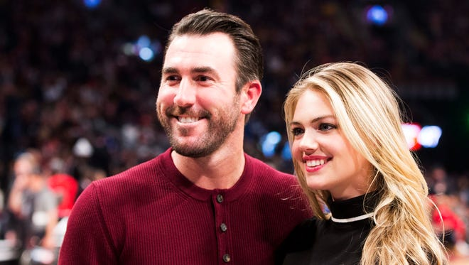 Detroit Tigers pitcher Justin Verlander, left, and model Kate Upton pose for a photograph during the NBA All-Star Game in Toronto on Sunday, Feb. 14, 2016.