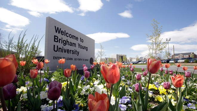 This April 19, 2016, file photo, shows a welcome sign to Brigham Young University in Provo, Utah. Utah public records officials are ordering the Provo and Orem police departments to release a report showing any time a Brigham Young University employee accessed police records. The Salt Lake Tribune reports the records committee ordered the police departments to release a report showing when BYU workers in the past year and a half accessed a police database.