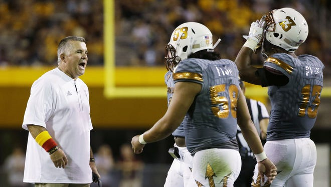 Arizona State coach Todd Graham has words for the defense against UCLA during Pac-12 action on Saturday, Oct. 8, 2016 in Tempe, Ariz.