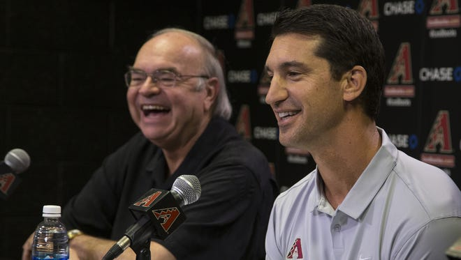 Diamondbacks General Manager Mike Hazen (right) is introduced to the media.