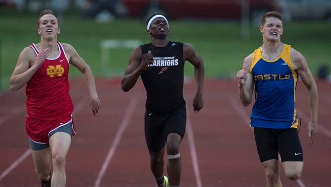 Castle's Noah McLean, right, inches ahead of Mater Dei's Nevin DeCoster, left, and Harrison's Robert Farmer to win the 400 meters at the IHSAA Central Boys Sectional Thursday evening.