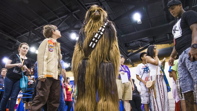 A very tall Chewbacca from Star Wars hangs out at Phoenix Comic Fest, Saturday, May 27, 2017, at the Phoenix Convention Center.