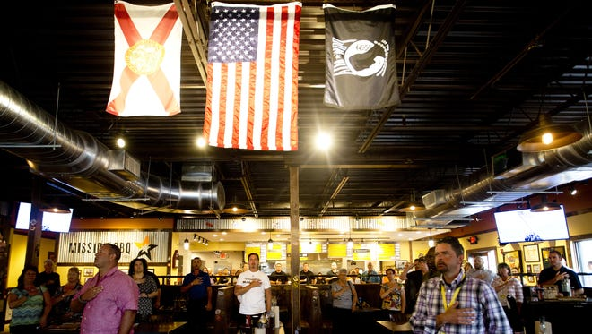 Patrons at every Mission BBQ restaurant stand for the national anthem, which is played daily at noon.