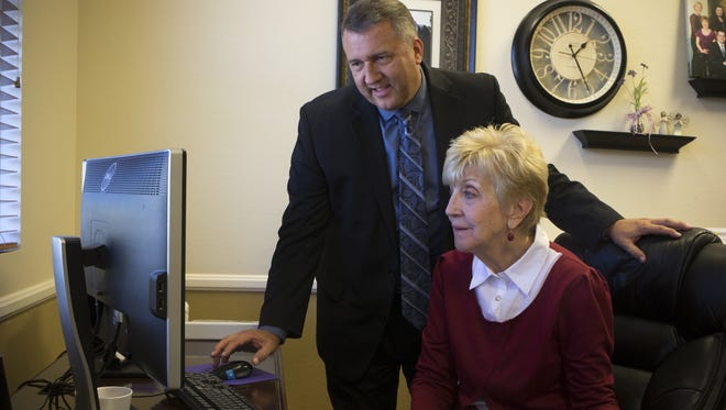 Rich Crandall (left) works with his mom, Linda Crandall, Sept. 27, 2017, in her office at Crandall Corporate Dietitians, 1930 N Arboleda, Mesa.