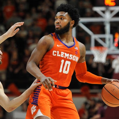 Clemson Tigers guard Gabe DeVoe (10) looks to pass