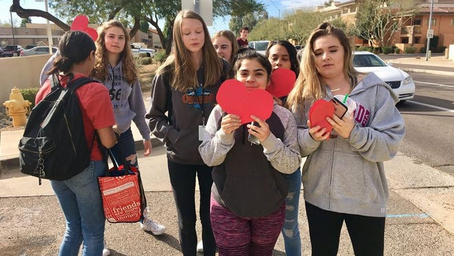 Students from Chaparral High School in Scottsdale participate in a walkout on February 23, 2018.