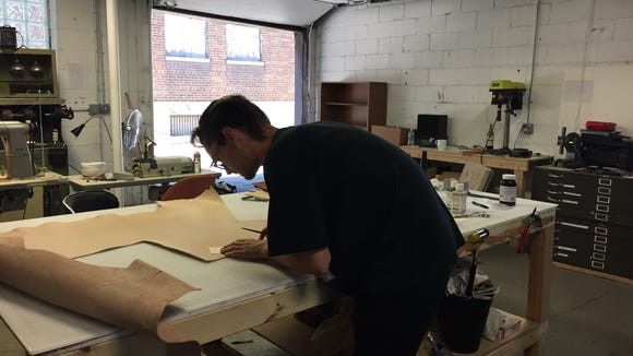 James Lee, 28, of Detroit, works with leather at Douglas