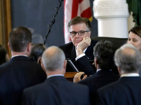 Lt. Gov. Dan Patrick, center, presides over the Texas Senate.