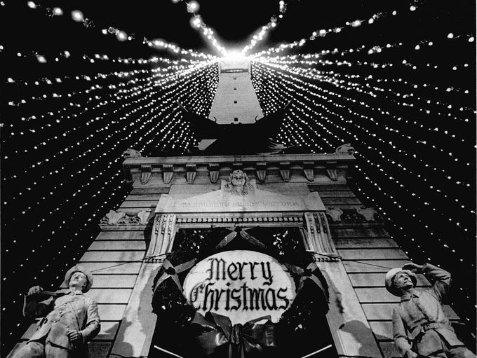 The Soldiers and Sailors Monument on Monument Circle is shown decorated for Christmas season in this photo taken on Nov. 27, 1964. Lights for the World's Largest Christmas Tree were strung on the monument for the first time in 1962.