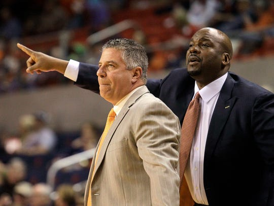 Chuck Person, right, has been fired by Auburn.