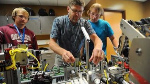 Mechatronics Technology instructor Bryan Cox shows