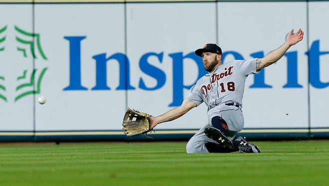 Tigers centerfielder Tyler Collins makes a sliding attempt on a single by Astros catcher Evan Gattis in the second inning Monday in Houston.