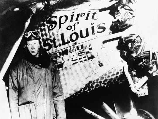 """Charles Lindbergh poses with the """"Spirit of St. Louis,"""""""
