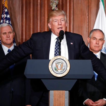 President Donald Trump, accompanied by from left, Vice