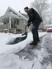 Bob Barton shovels snow on Spring Street in South Nyack