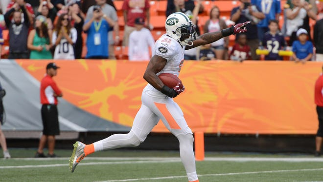 Team Rice cornerback Antonio Cromartie of the New York Jets (31) celebrates after catching the football on a Team Sanders' field goal attempt during the fourth quarter of the 2014 Pro Bowl at Aloha Stadium.