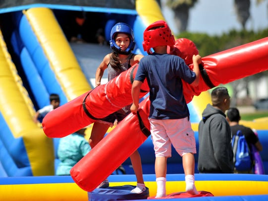 Arianna Cisneros, left, of Oxnard, duels Knox Belew, of Port Hueneme, in a game during the Boys & Girls Clubs of Oxnard and Greater Port Hueneme Day for Kids on Saturday.