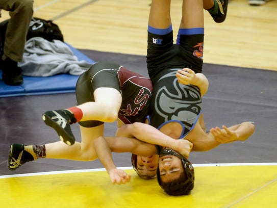 South Kitsap wrestler Xavier Eaglin flips over  Noah