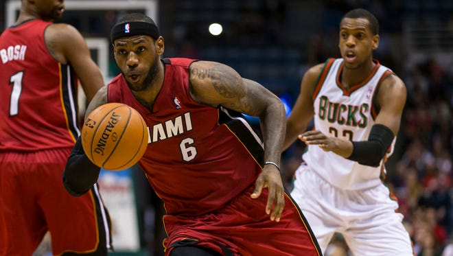 Miami Heat forward LeBron James (6) drives for the basket during the first quarter against the Milwaukee Bucks at BMO Harris Bradley Center.