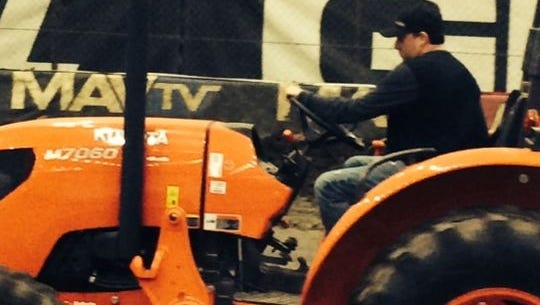 Tony Stewart operates a tractor at the River Spirit Expo Center in Tulsa - home of the Chili Bowl.