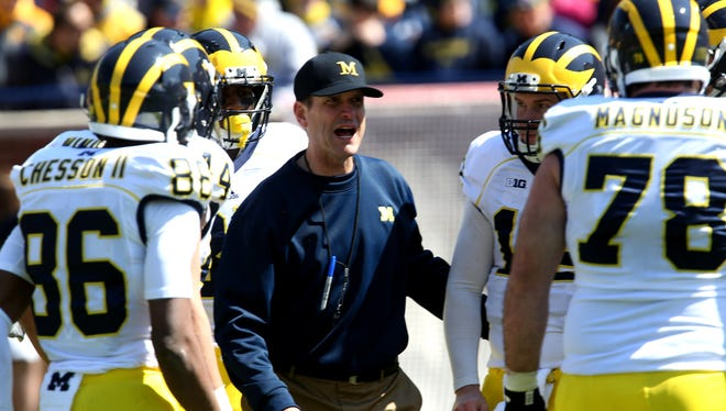 Michigan coach Jim Harbaugh coaches the Maize team during the Michigan spring football game on April 4, 2015.