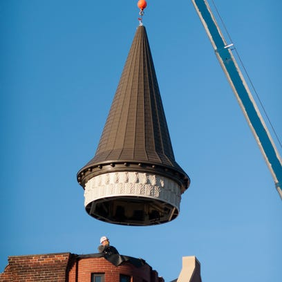 """The """"witch's hat"""" steeple was hoisted up by a crane"""